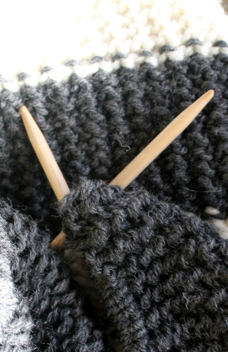 Keeping cosy knitting a throw from New Zealand wool.