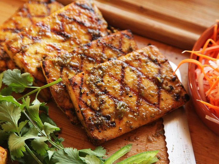 """How to grill good tofu: Use firm non-silken tofu (use that in soups/stews). Cut into large slabs 1/3"""" wide. Dry the slices well. Use thick marinades sparingly. Cook on a clean, well-oiled grill, covered, using low indirect heat. It should take 20 mins. Add more marinade after cooking. 