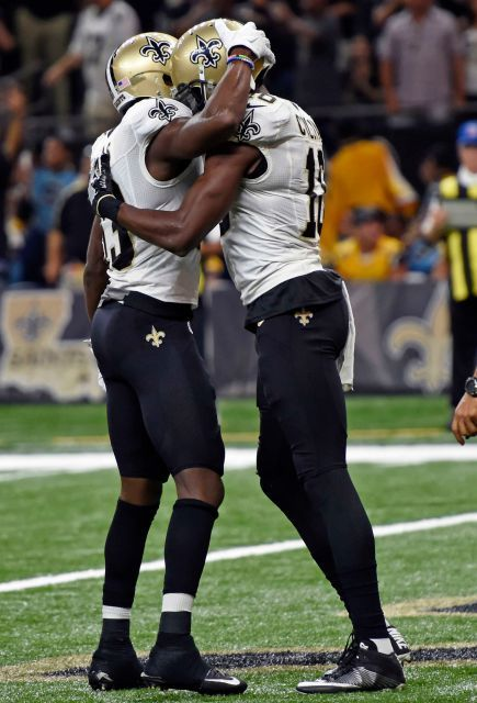 New Orleans Saints wide receiver Michael Thomas, center, celebrates his touchdown with quarterback Drew Brees (9) and wide receiver Brandon Coleman in the first half of an NFL football game in New Orleans, Monday, Sept. 26, 2016.
