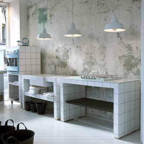 Utilitarian Danish Kitchen: distressed wall with bare plaster, tiles, pendant lights; Det Mondaene Skur #home #interiors