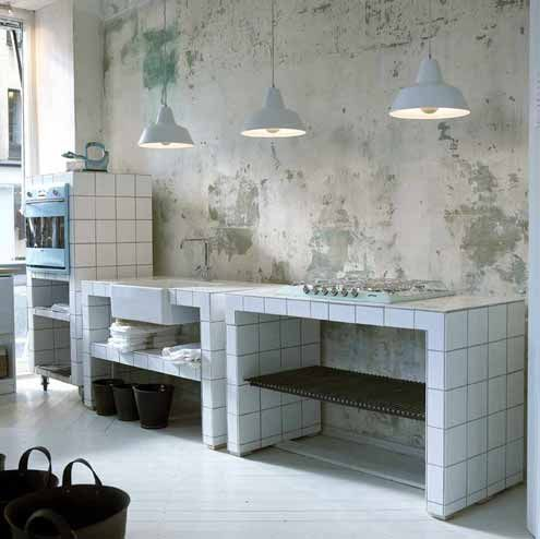 Utilitarian Danish Kitchen: distressed wall with bare plaster, tiles, pendant…