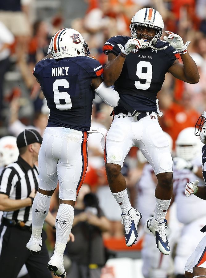Auburn Football - Tigers Photos - ESPN AUBURN, AL - AUGUST 30: Defensive back Jermaine Whitehead #9 of the Auburn Tigers celebrates his interception for a touchdown with defensive back Jonathan Mincy #6 during the game against the Arkansas Razorbacks at Jordan Hare Stadium on August 30, 2014 in Auburn, Alabama. (Photo by Mike Zarrilli/Getty Images)