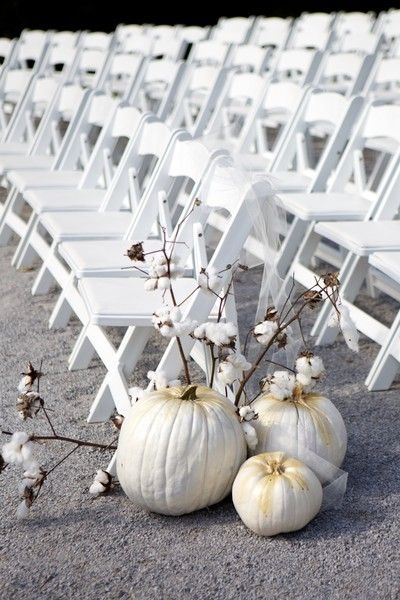 White pumpkins and cotton were used as aisle markers - southern fall wedding decor idea {Arden Photography}