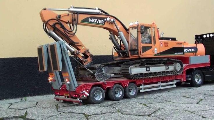 RC Volvo truck transports Excavator