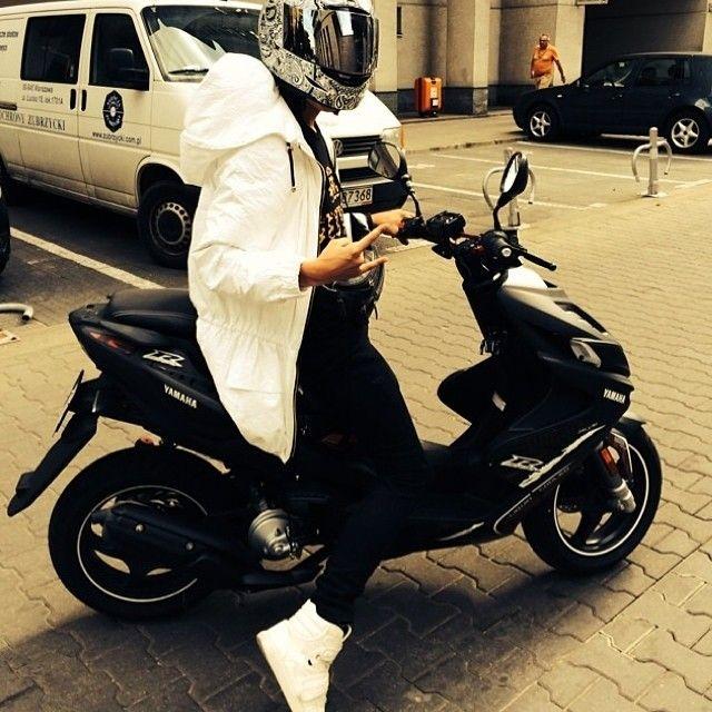 Dawid Kwiatkowski wearing white parka jacket by madox design