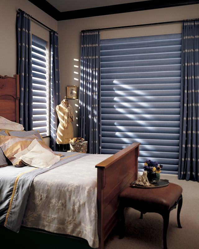 Classic blue and white, denim inspired bedroom decor with Pirouette® window shadings ♦ Hunter Douglas window treatments