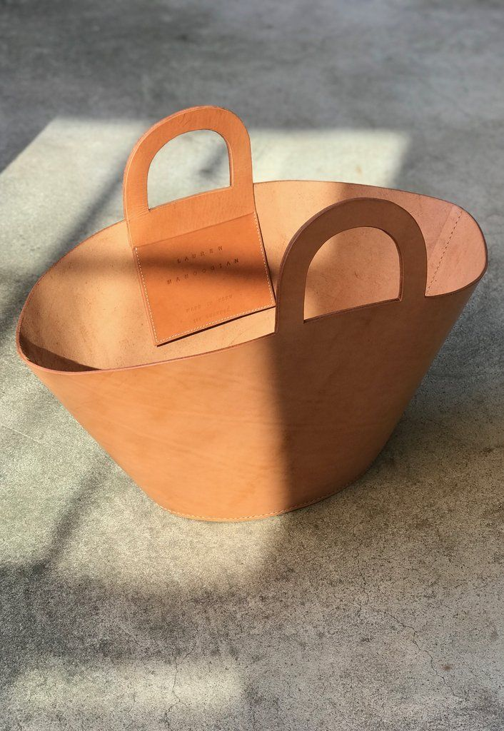 Oversized basket bag shape in vegetable tanned leather from Lauren Manoogian.  Rounded handles with one large interior pocket. 11