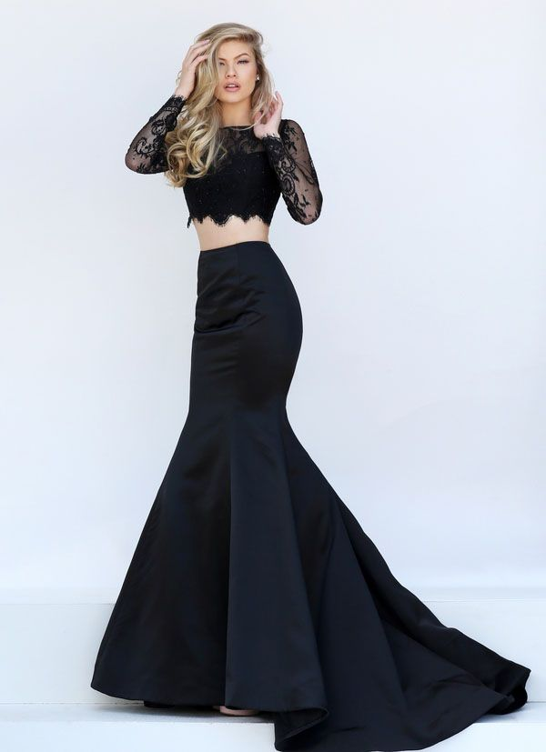 Long sleeve black lace two-piece prom dress delicately accented with beads perfectly matches a fitted trumpet taffeta skirt. Colors: pink, navy, coral, plum