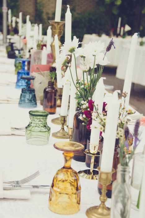 A lovely jewel tone tablescape with vintage colored glassware Save wine bottles and beer bottles to make this?!