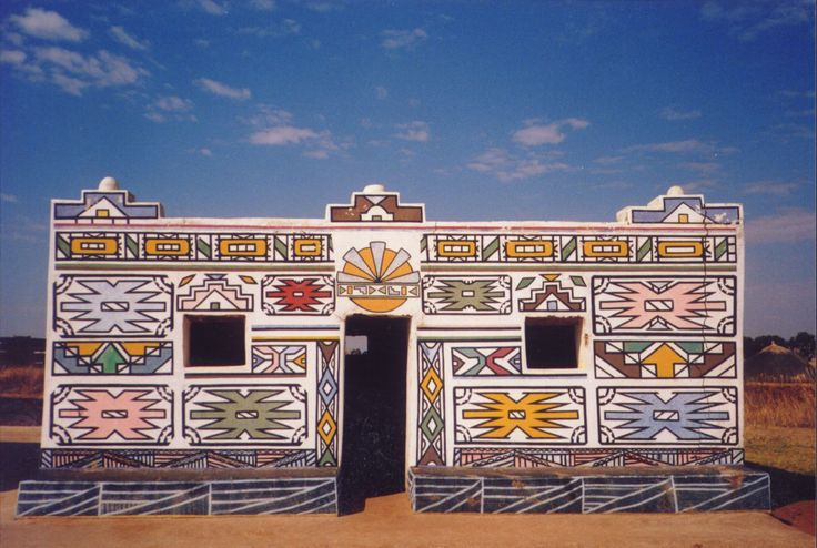 The Ndebele people. For over a hundred years, the Ndebele have decorated the outside of their homes with designs. Multi color wall paintings are painted by using their fingers, the most frequent theme, as in wall painting, is the house. Gables, gateways, steps, roofline's and light fixtures may all be recognized on women's aprons and on walls. These reflect the domestic interests of women, and may point to aspirations of idealized homes.