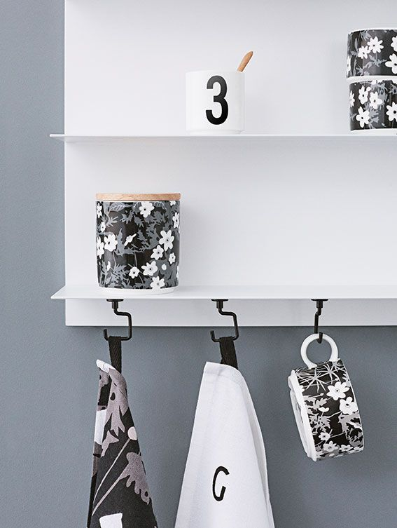White Paper Shelf in the kitchen with our magnetic Tool Hook to hang tea towels and cups. Designs: Flowers by AJ and AJ Vintage ABC.