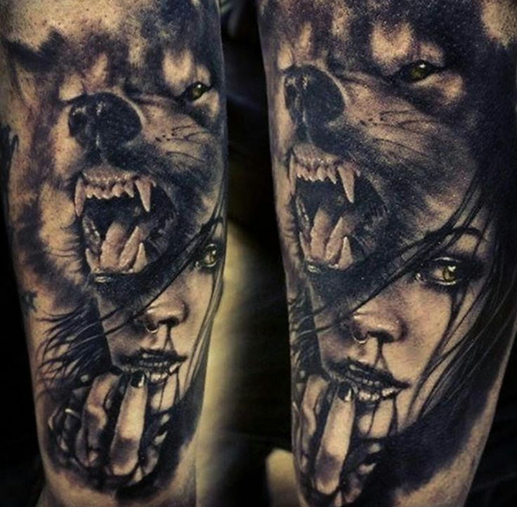 Wolf with woman tattoo