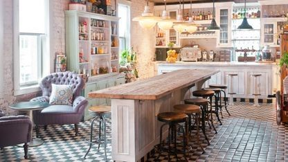 Kitchen inspiration from the best hotels around the world: Soho House, New York, New York More brilliance from the Soho House group with the Pantry Bar in New York City. Be inspired by the small green and white checkerboard tiles and distressed looks cabinetry for a tough yet feminine look in your own kitchen.