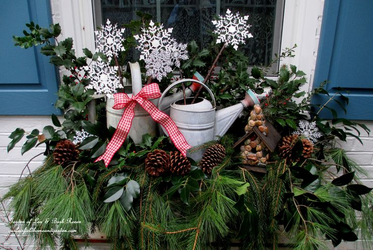 Rustic Watering Cans Windowboxes for Winter   http://ourfairfieldhomeandgarden.com/rustic-watering-cans-windowboxes-more/
