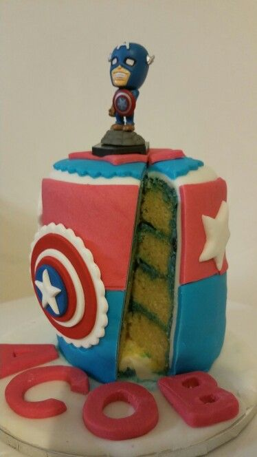 Super hero cake (lemon cake with blueberry frosting and covered in fondant)