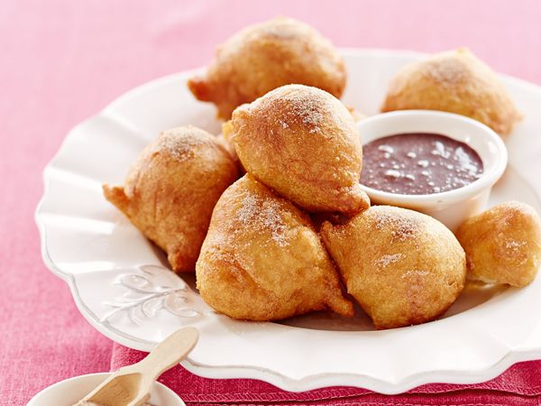 Vetkoekies with spiced chocolate dipping sauce http://www.eatout.co.za/recipe/vetkoekies-spiced-chocolate-dipping-sauce/