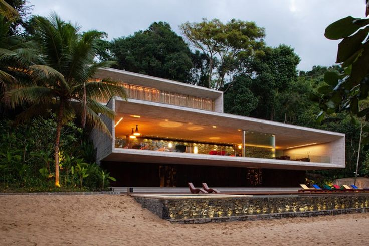 Marcio Kogan Architects designed this luxury beach house on a coastal island between Sao Paolo and Rio De Janeiro