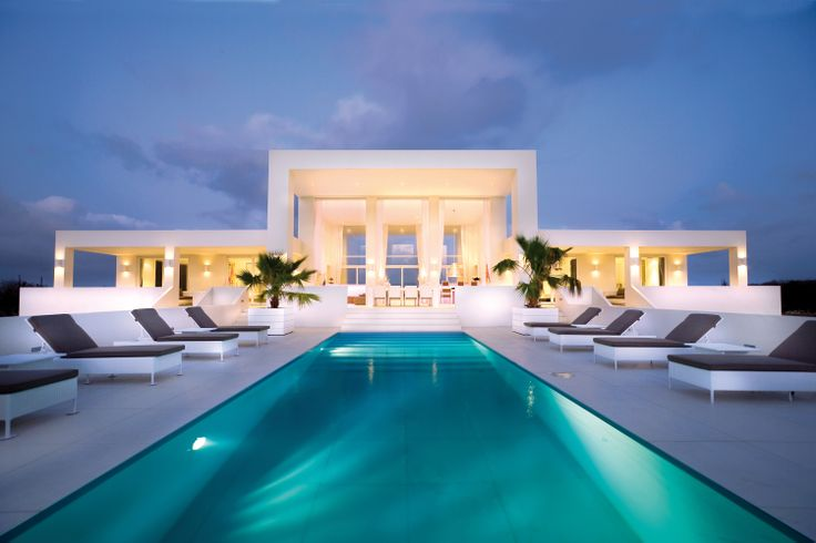 White and blue Villa at Coral Estate Abou in Curacao by Jan Des Bouvrie. Photo by Hans Fonk