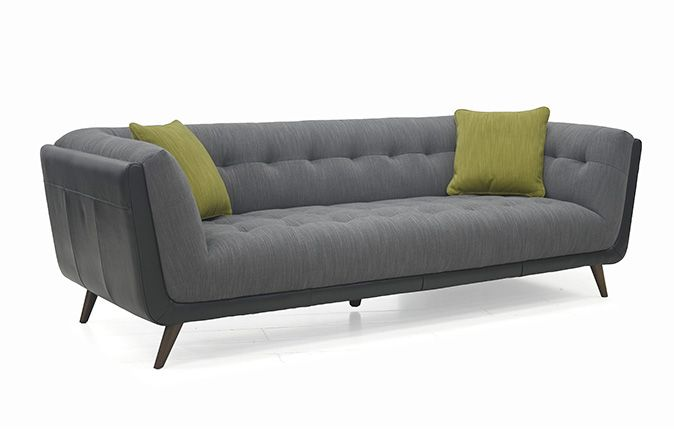 The Bermuda 2.5 Seater Sofa   In a sleek retro style is stunning and will stand out in any living setting.  Finished in contrasting faux suede fabric with deep button tufted detail this sofa not only looks good but feels good too!   Ideal for a contemporary setting the Bermuda features low back and high armrests.   To make you feel snug and comfortable with pocket sprung seats.   Retro style legs. 10 year frame guarantee on this sofa.