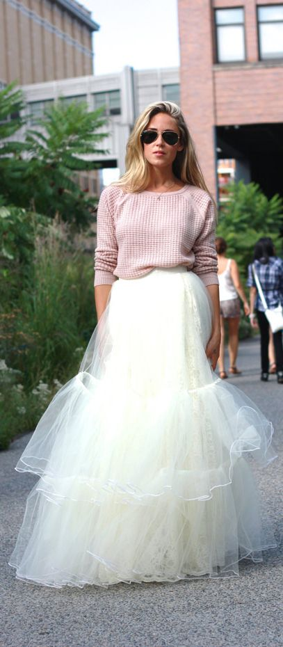 Cara McLeay is wearing a pink jumper from Vince and white tulle skirt from AFLA