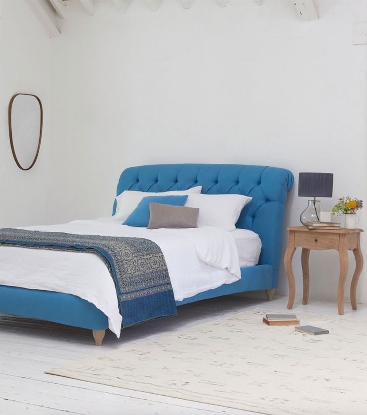 This seriously comfy bed has curves in all the right places. With those deep buttons, that scrolling headboard and satisfyingly padded sides, it takes squish to the next level. Shown here in