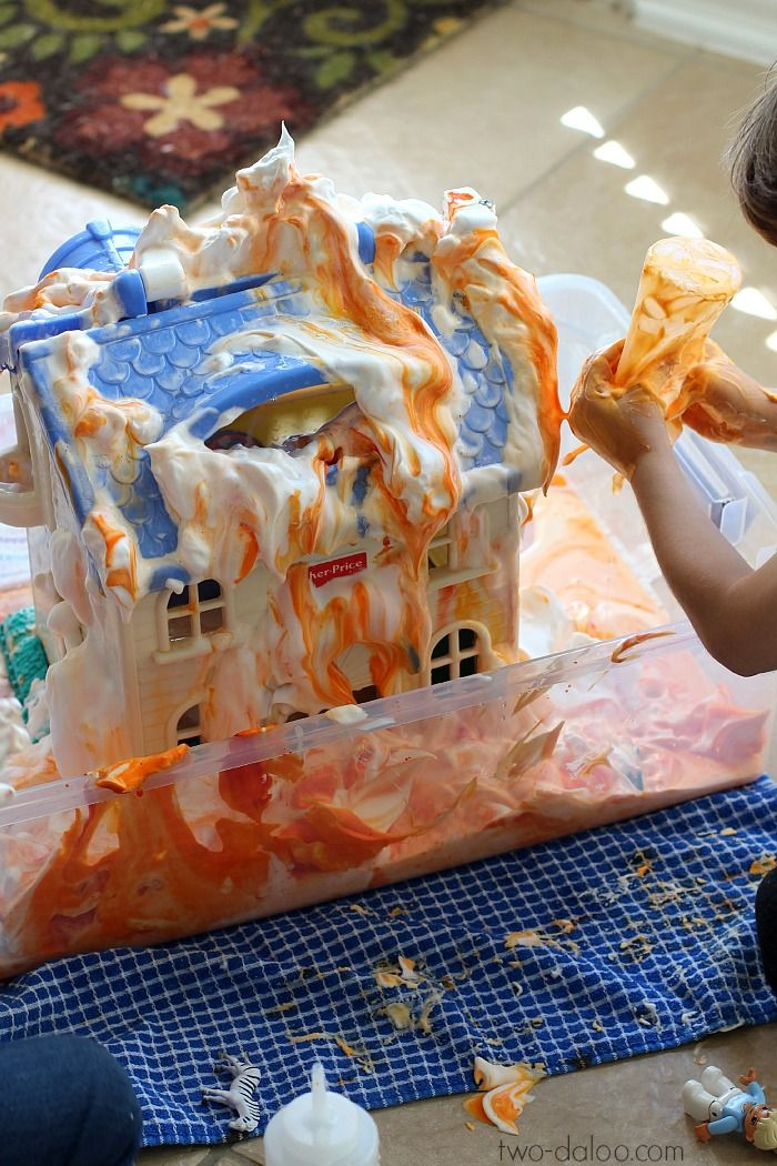 "Create a vibrantly colored ""burning building"" with this easy sensory play idea! Great for community helpers and firefighter themes, fine motor, dramatic play."
