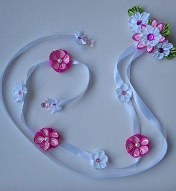 haar klem met vlecht versiering roze bloemen