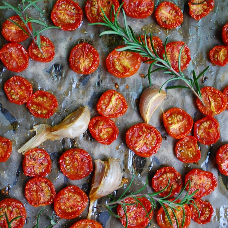 Garlic & Rosemary Slow Roasted Tomatoes are a flavorful alternative to canning for preserving tomatoes. Use in pasta, salads, or on pizzas.
