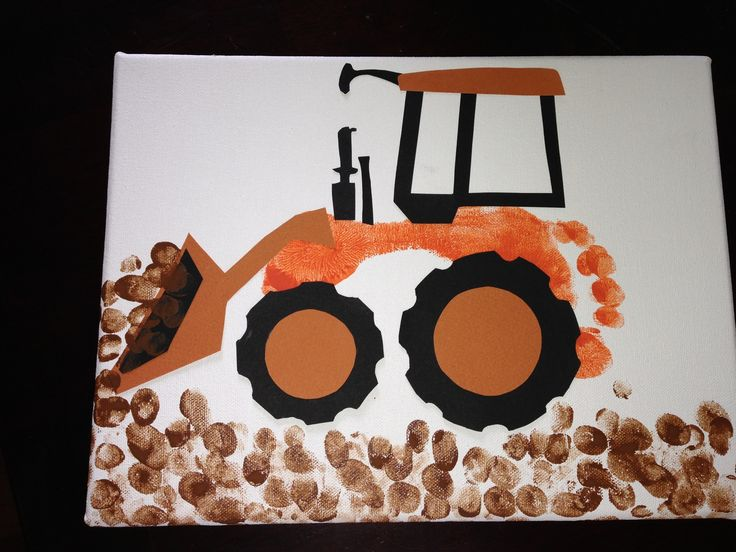 Saw the cute John Deere footprint tractors, but needed a Kubota tractor for a gift...so we made one. My son's foot is the body and his fingerprints are the dirt. I just free hand cut the card stock to create the other pieces. I am gonna modpodge over the top to protect it.