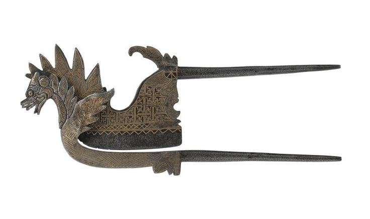 Betel cutter shaped like a dragon, iron damascened in silver: India, late 19th century © National Museums Scotland