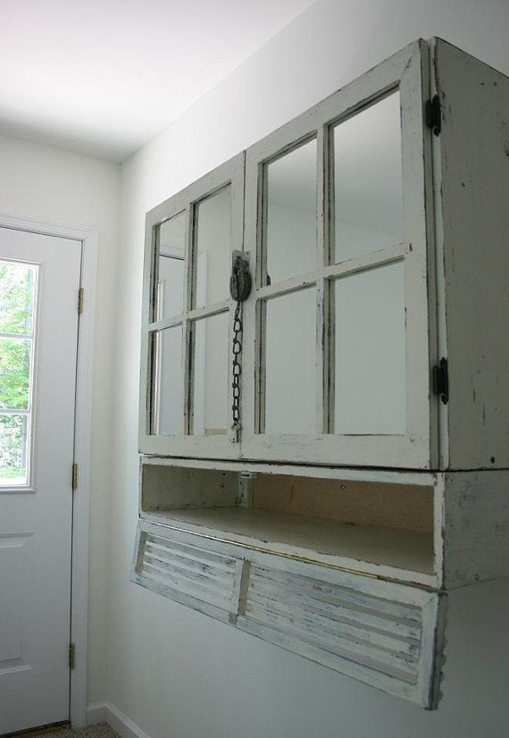 This Looks Like A Double Door Cabinet With Window Pane