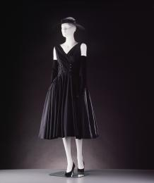 Black silk evening dress, sleeveless, fitted bodice, designed by Jacques Fath.
