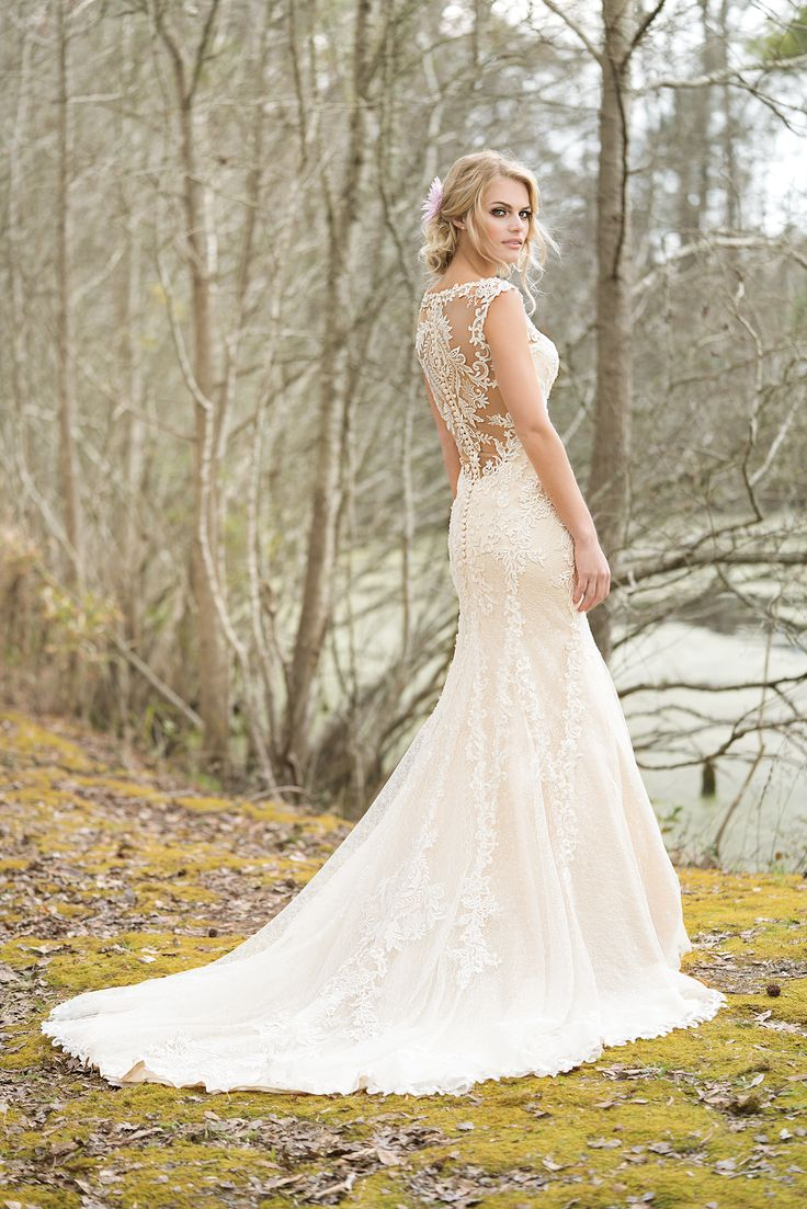 A V-neck fit and flare gown with the perfect lace details. Sequined lace appliques over Chantilly lace, laser cut top stitched lace, a deep illusion back, and finished hem lace create this gorgeous gown.