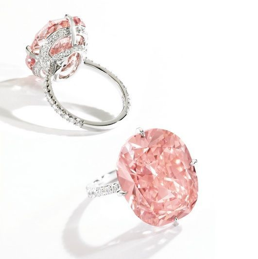 Magnificent Platinum, Fancy Intense Orangy Pink Diamond and Diamond Ring – The cushion-cut Fancy Intense Orangy Pink diamond weighing 15.23 carats, the mounting accented by round diamonds weighing .76 carat