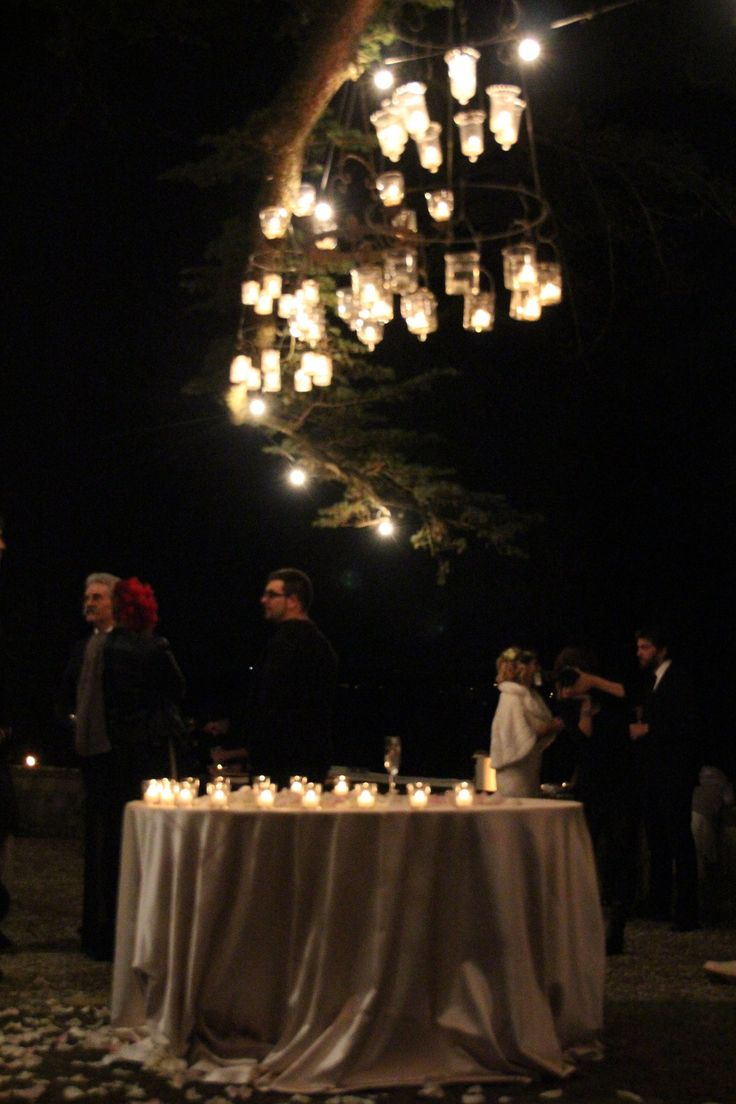 three chandeliers on the century old tree for your cake cut