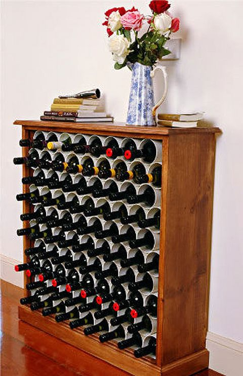 Learn how to make an affordable wine rack out of a bookcase and PVC pipe from…