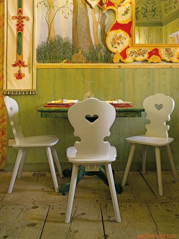 Rustic chair with heart on the backrest
