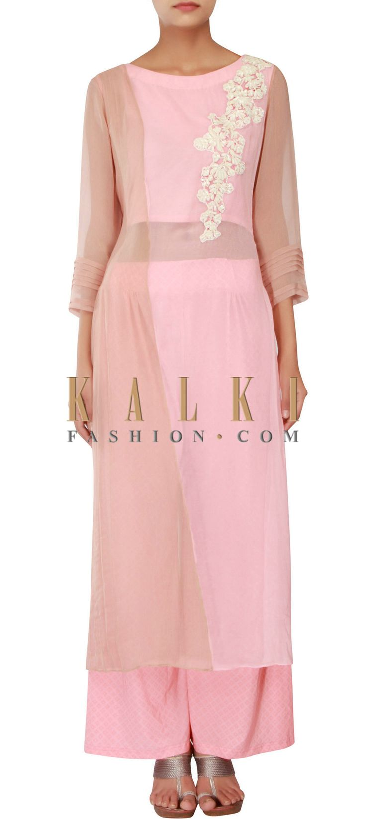 Buy Online from the link below. We ship worldwide (Free Shipping over US$100) http://www.kalkifashion.com/peach-and-grey-straight-fit-suit-adorn-in-thread-and-pleat-embroidery-only-on-kalki.html