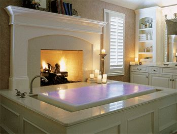 Infinity tub and a fireplace.  Two things I wish I had in my house in one beautiful bathroom.