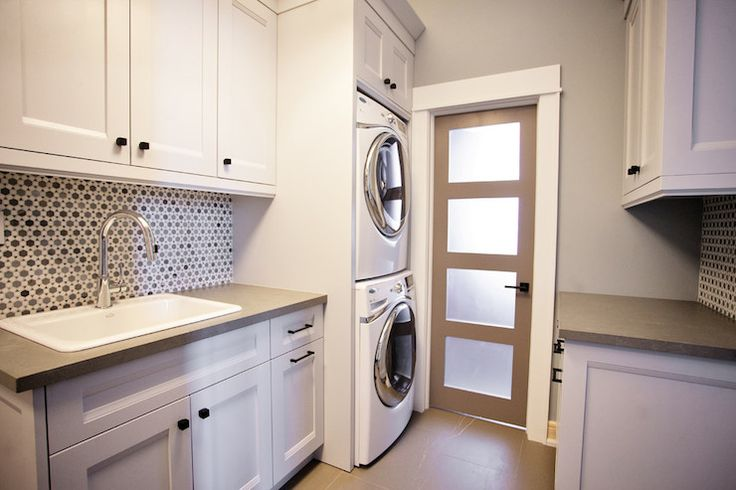 Nice and modern laundry... THE DOOR!!! I need this door on my laundry room!!