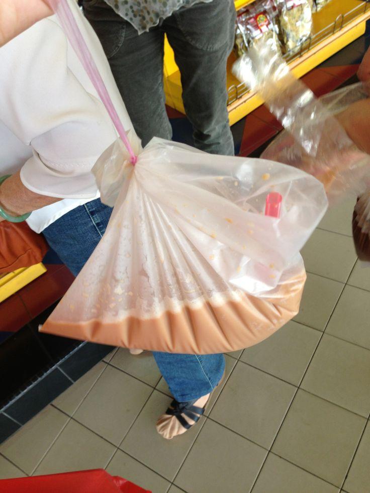 Teh Tarik. Pulled tea served in takeaway plastic bags.