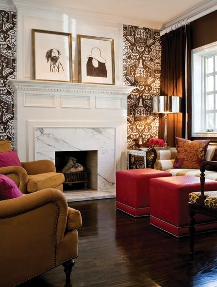 Love the concept of  wallpaper accent wall,, hate the paper and marble finish fireplace though.
