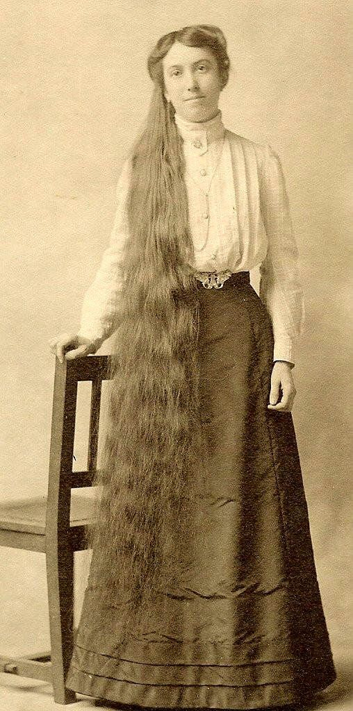 Weird that long hair like this was the fashion ideal at one time. I don't think most women today would have the patience even to brush it out at night, never mind style it!  :)