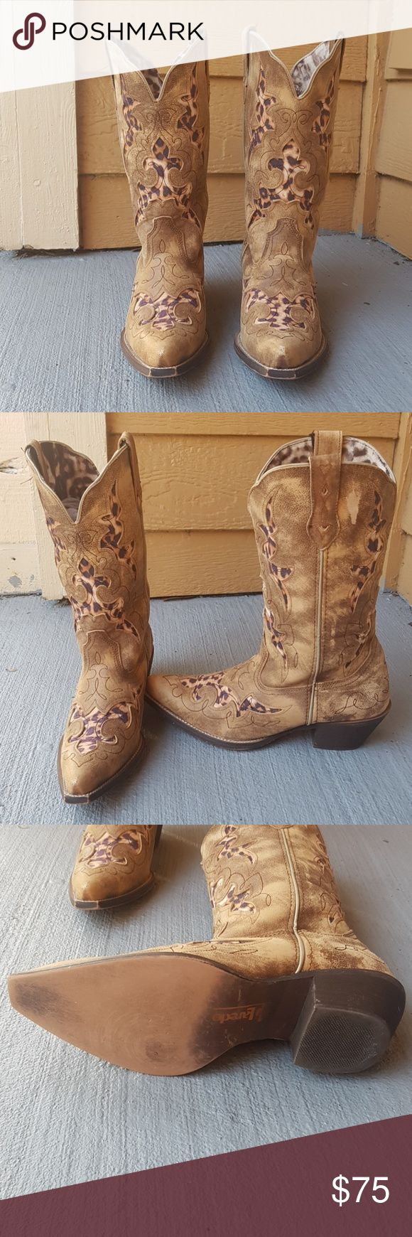 Cowboy boots with animal print detail Very comfortable cowboy boots with beautiful animal print details. They have a couple of scuff on the tip of the boots and one on the side as you can see in the picture but they are in great condition overall. Laredo Shoes Combat & Moto Boots