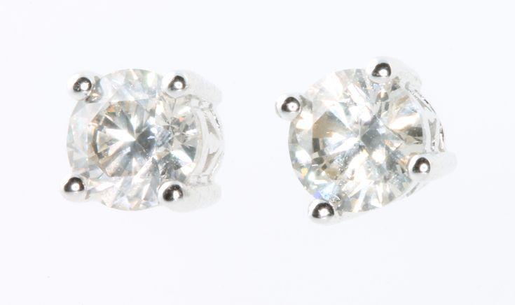 Lot 483, A pair of 18ct white gold brilliant cut diamond ear studs, 2.02ct, est £3600-3900