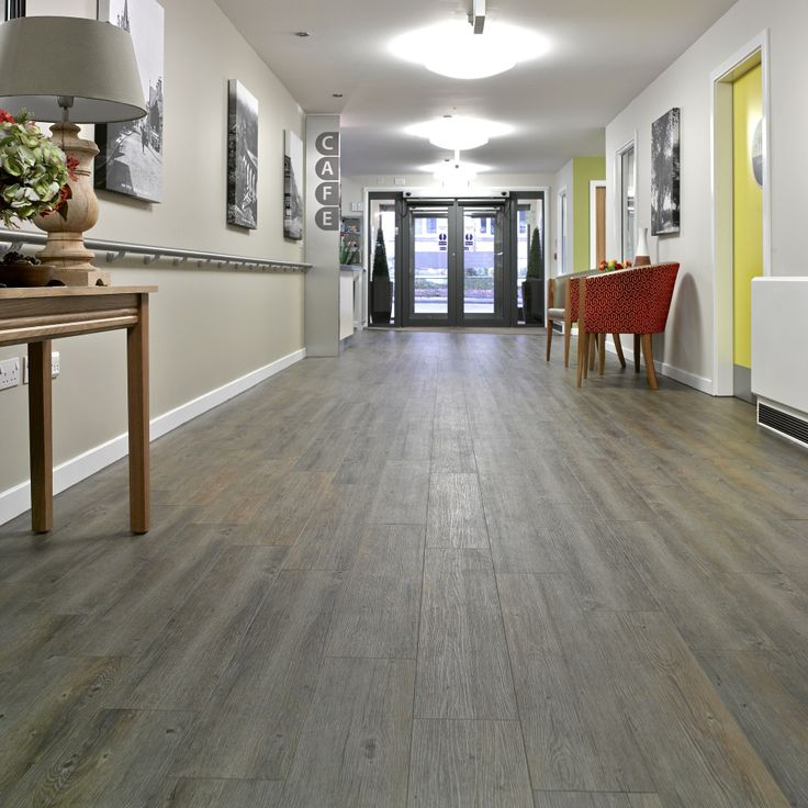Architects Hackland + Dore decided these wood effect, bevel-edged 'planks' made by vinyl flooring specialist Gerflor.