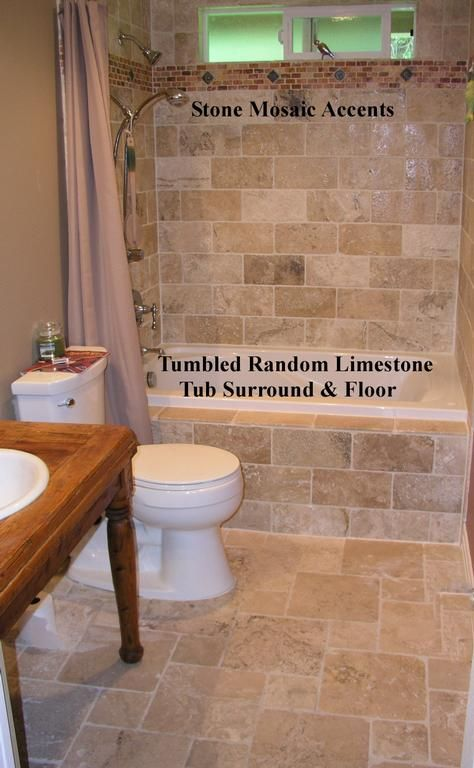 Tumbled Stone Tub  Surround & Floor provided by The Sandel Group -Tile-Stone-Glass Installations Duvall 98019