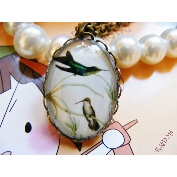 Necklace with drawing of bird, made of brass base. Size of the picture is 18x25mm and is covered with cabochon glass.