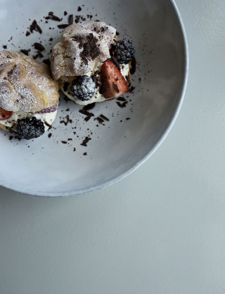A beautiful dessert with fresh berries served on tinekhome tableware.