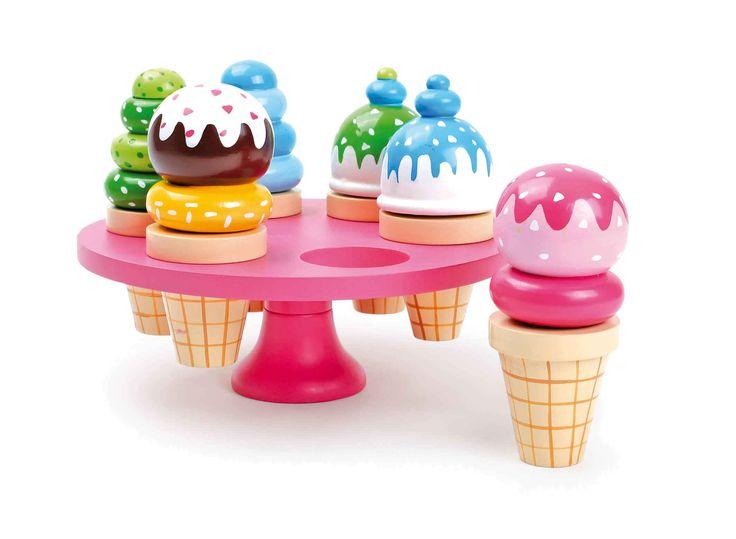 Deze roze houten ijsstand biedt een potpourri van bonte ijsjes. De kleurige ijswafels kunnen makkelijk in de ronde openingen gestopt worden en ieder kind kan naar believen een lekker ijsje zelfs nemen. So druppelt ook niets op de grond!